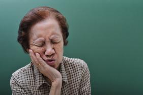 An elderly woman suffering from lack of dental care to her teeth.